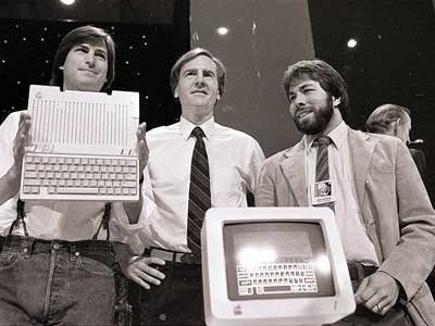 "John Sculley with Steve Jobs and Steve Wozniak. Sculley was famously lured from Pepsi by Jobs who asked him ""Do you want to sell sugar water for the rest of your life, or do you want to come with me and change the world?"""